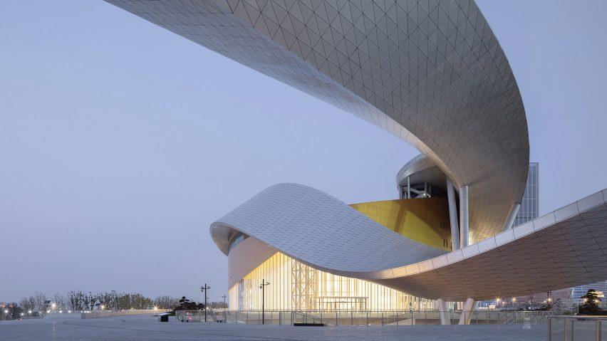 The metallic ribbon that enfolds Suzhou Bay Cultural Center by Christian de Portzamparc