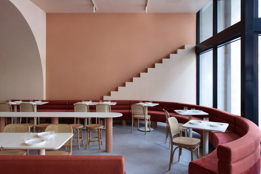 curved banquette seating at The Budapest Cafe by Biasol