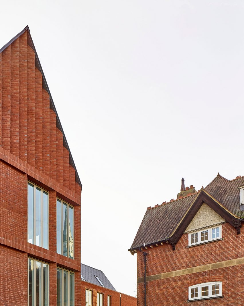Windows are dotted across the facade amongst red brick