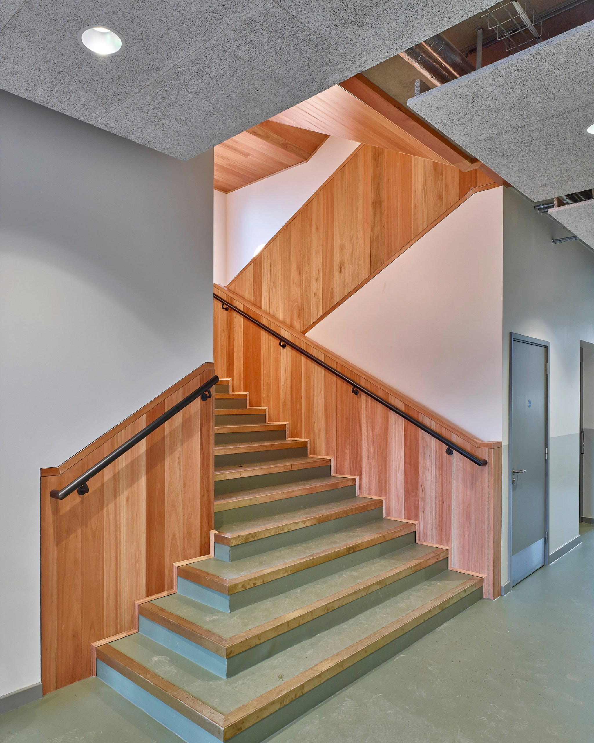 Timber lined stairwell with metal treads