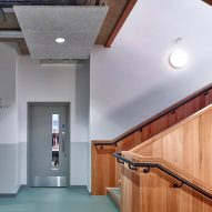 Corridor to classrooms next to timber stairwell