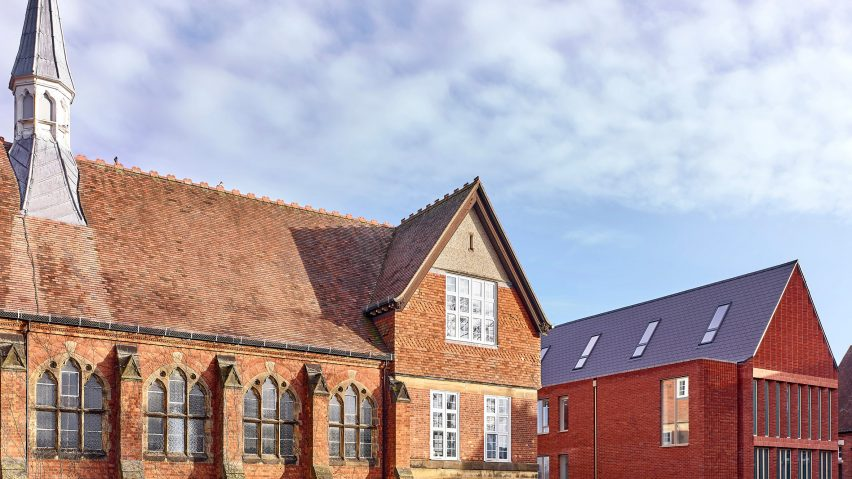 New gabled extension next to red brick Victorian structure