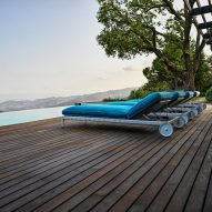 Pool loungers at Villa Nemes by Giordano Hadamik Architects