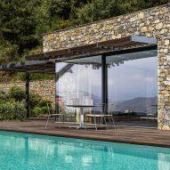 Giordano Hadamik Architects builds hillside Villa Nemes using stone excavated on site