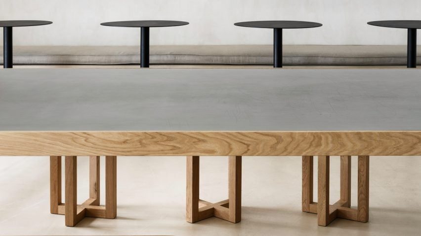 Communal dining table at Zuppa restaurant by Plantea Estudio made from wood and steel