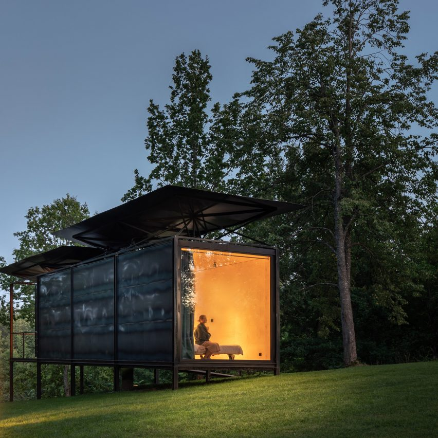 Glowing window on 019 Cabin by ŠA Atelier and Piritas