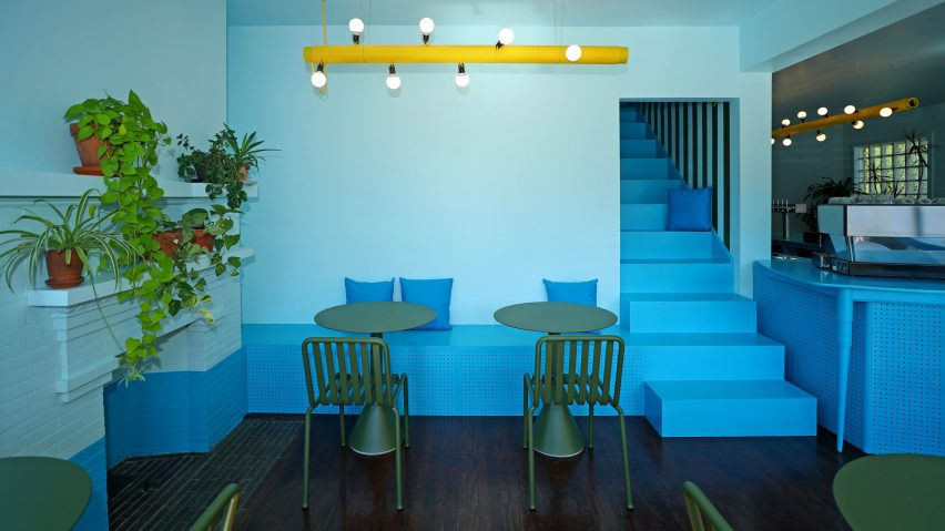 Tipico's seating areas feature olive green garden tables and chairs