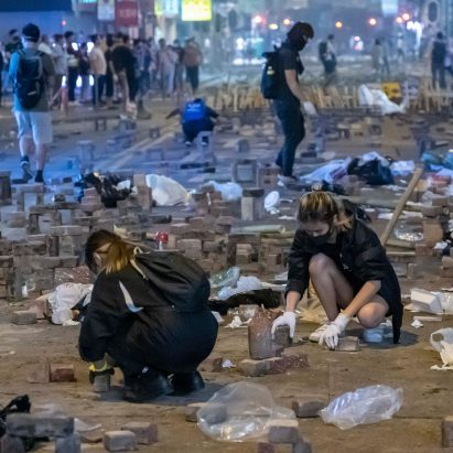 A close up image of the Hong Kong protesters laying down their Brick Arches
