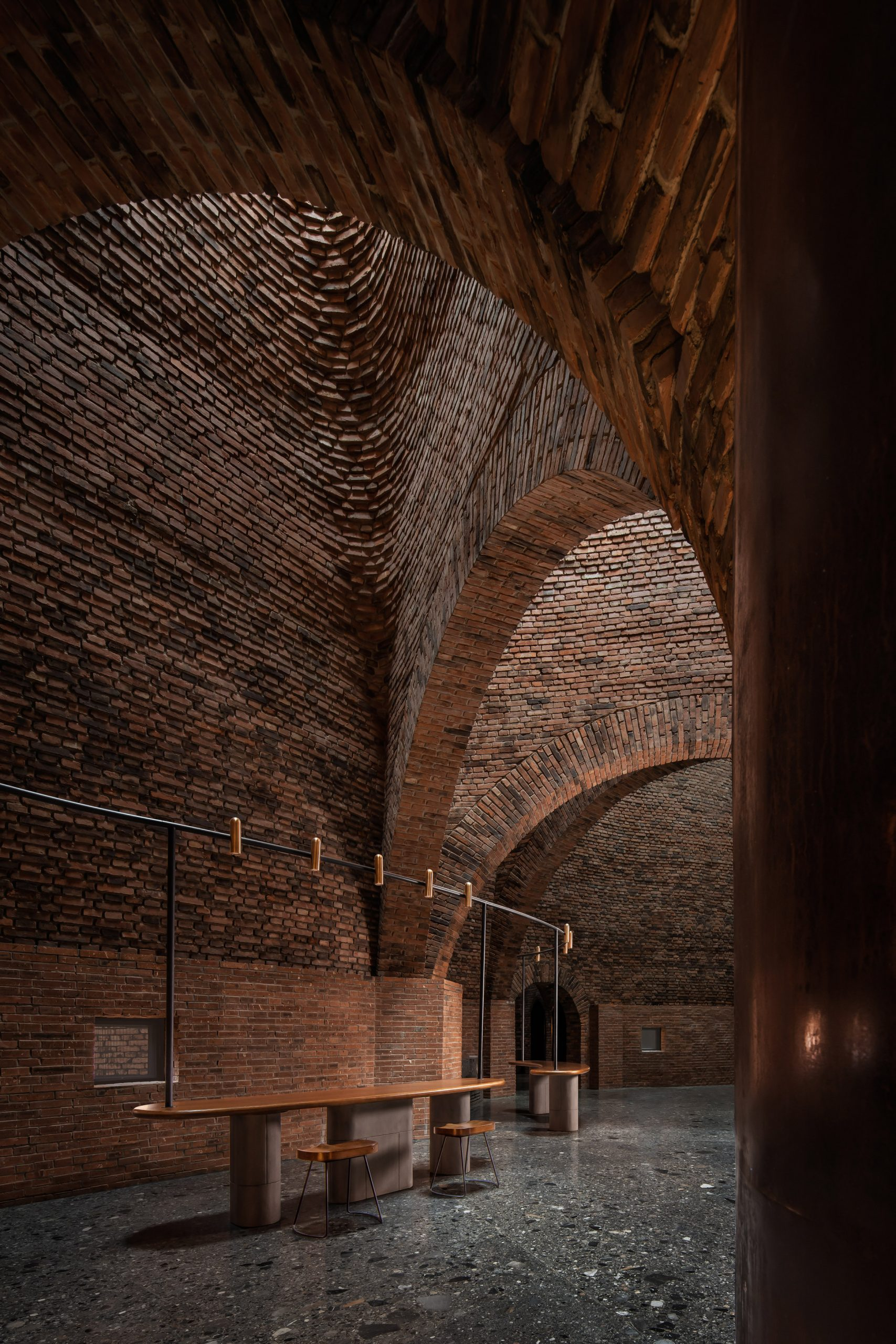 A restaurant with arched red-brick interiors