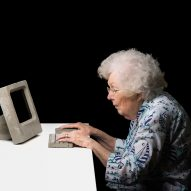 A photograph of a computer user interacting with one of the prototypes