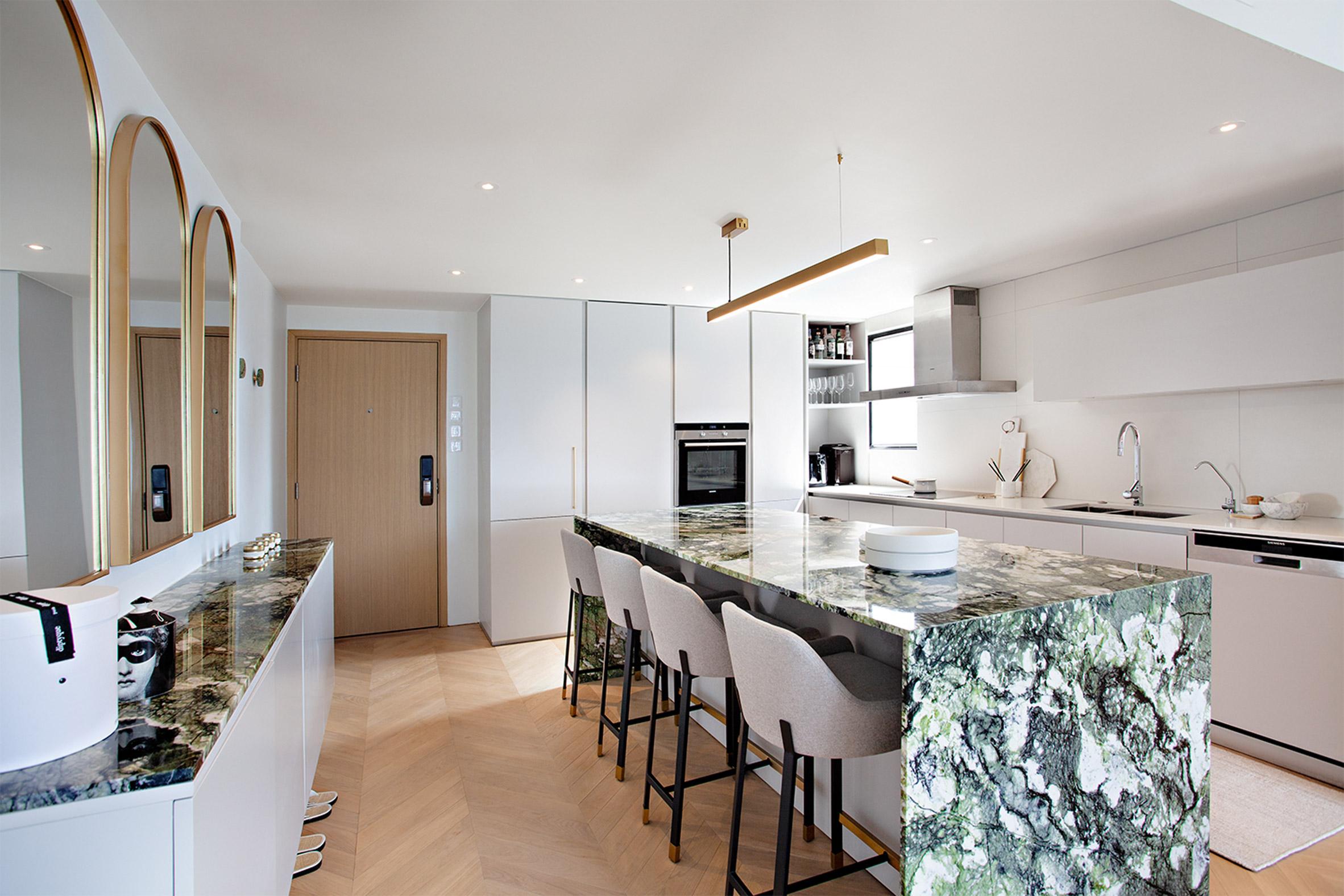 Green marble kitchen table in white kitchen