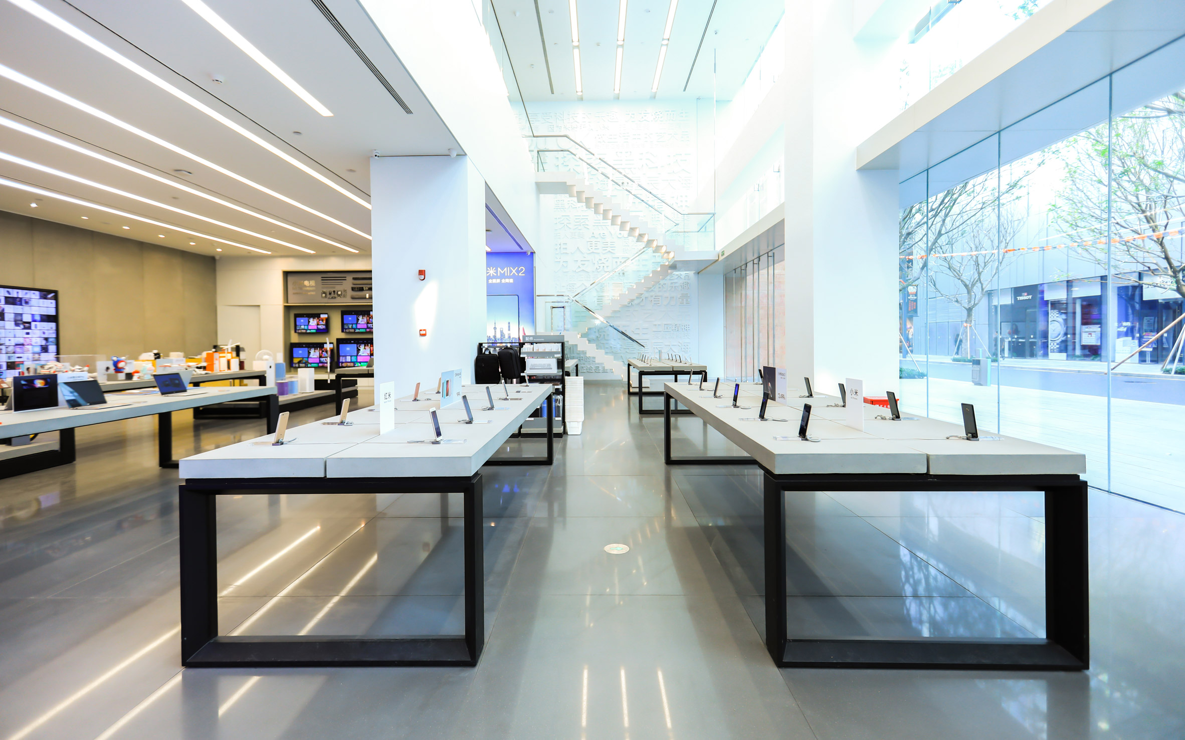 White tables inside Xiaomi flagship store