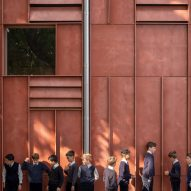 Jonathan Tuckey Design creates school theatre clad with red cement