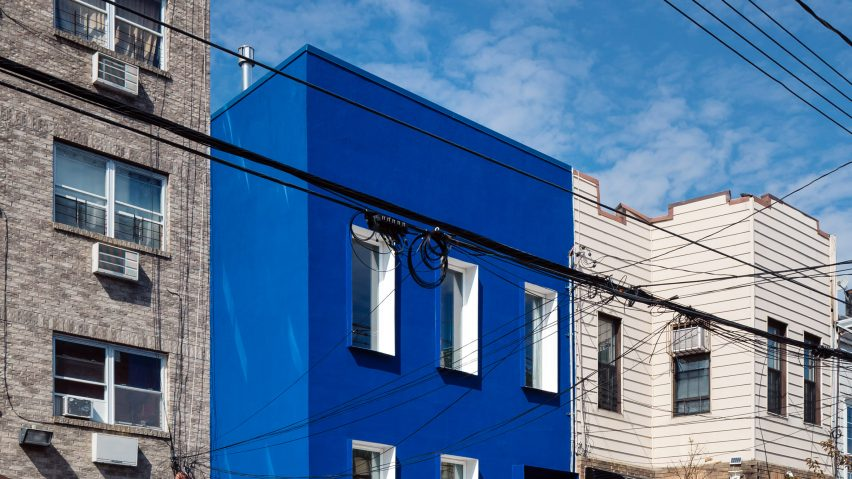 The Blue Building contrasts with surrounding buildings