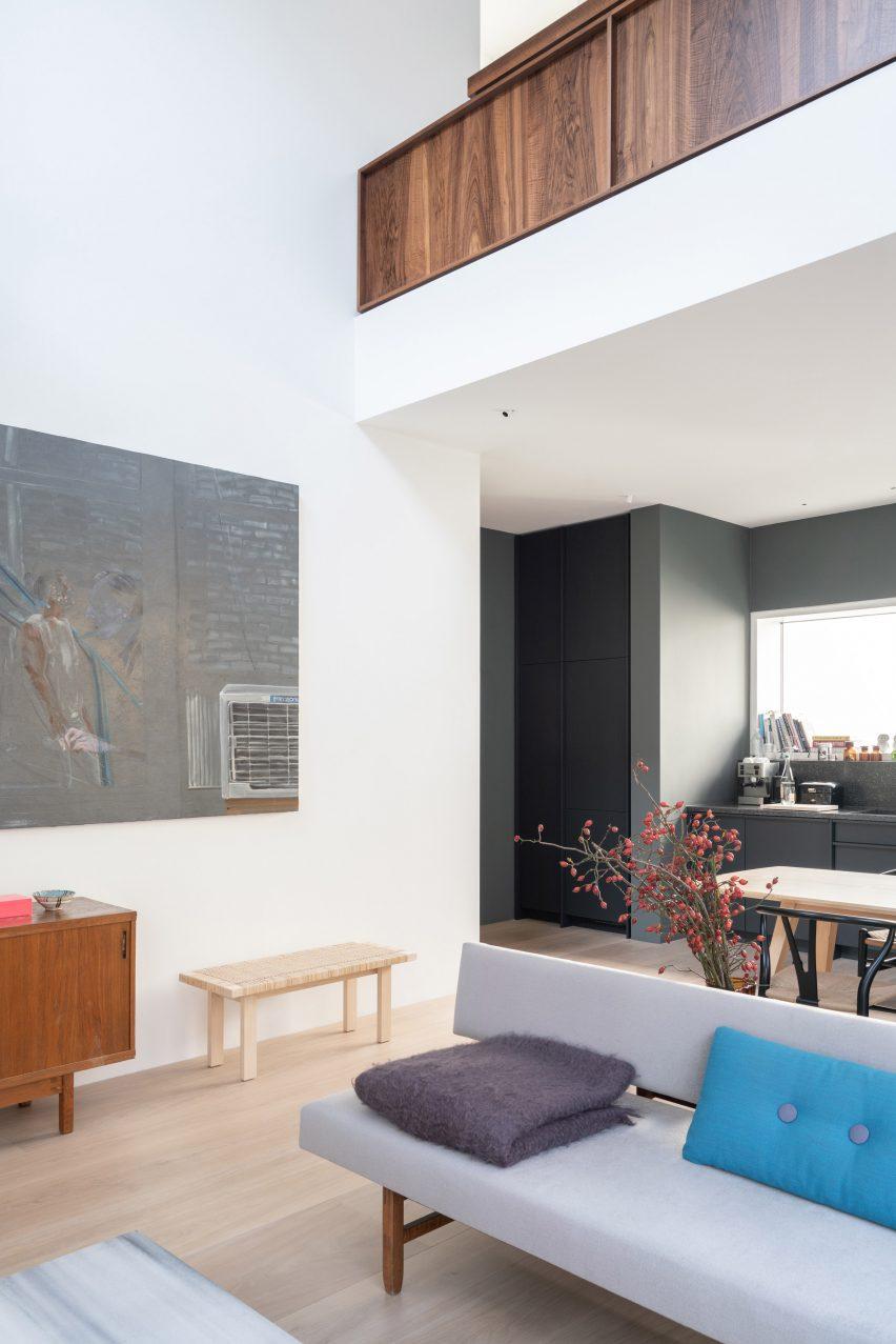The mezzanine level has a walnut balustrade