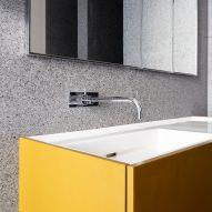 Yellow bathroom cabinetry