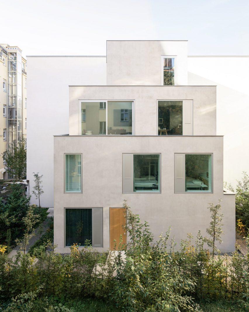 The grey stacked home is located in a Berlin courtyard by Batek Architekten