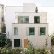 Batek Architekten uses stacked volumes to create Berlin duplex townhouse