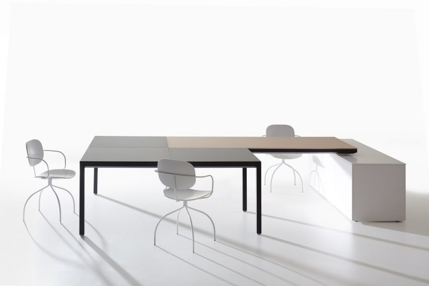 IOC Project Partners workstation with several chairs and a cabinet