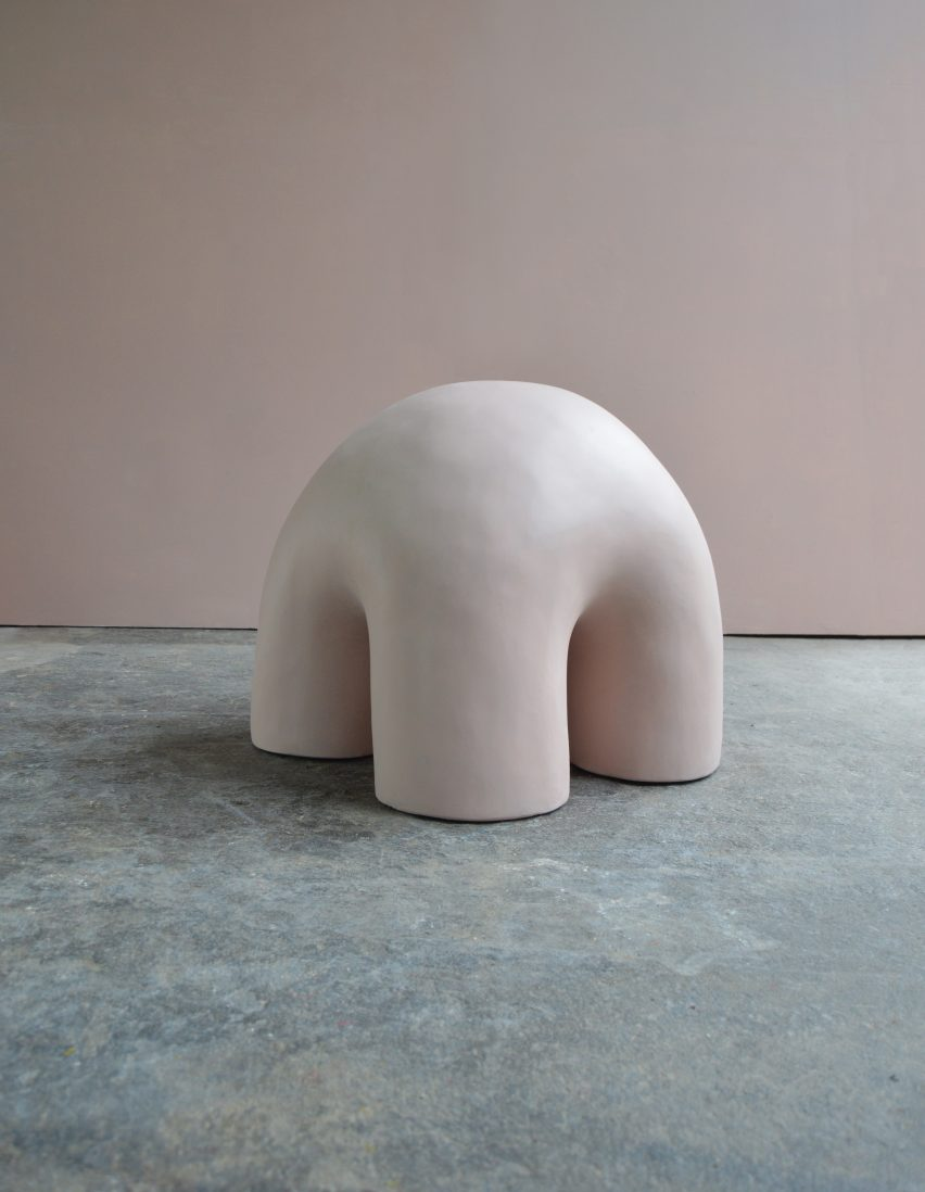 A separate pastel bedroom features furniture like this stool