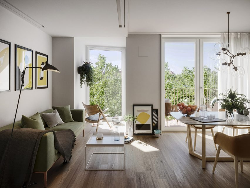 Interior view of an apartment with views out to tree-line
