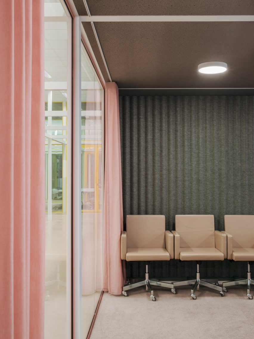 Pink curtains are paired with muted green walls