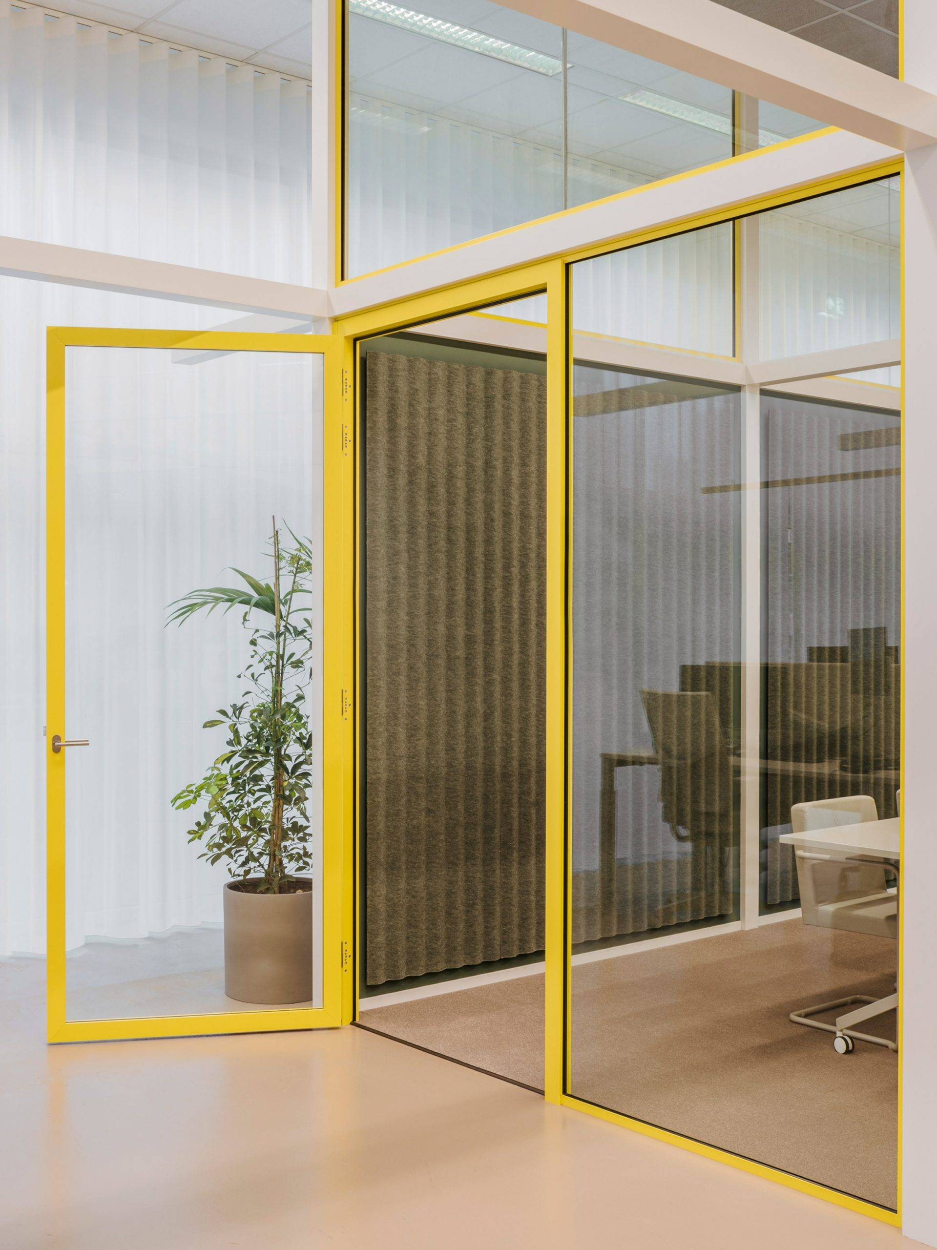 Carpet and felt covers the walls and floors in the enclosed office spaces