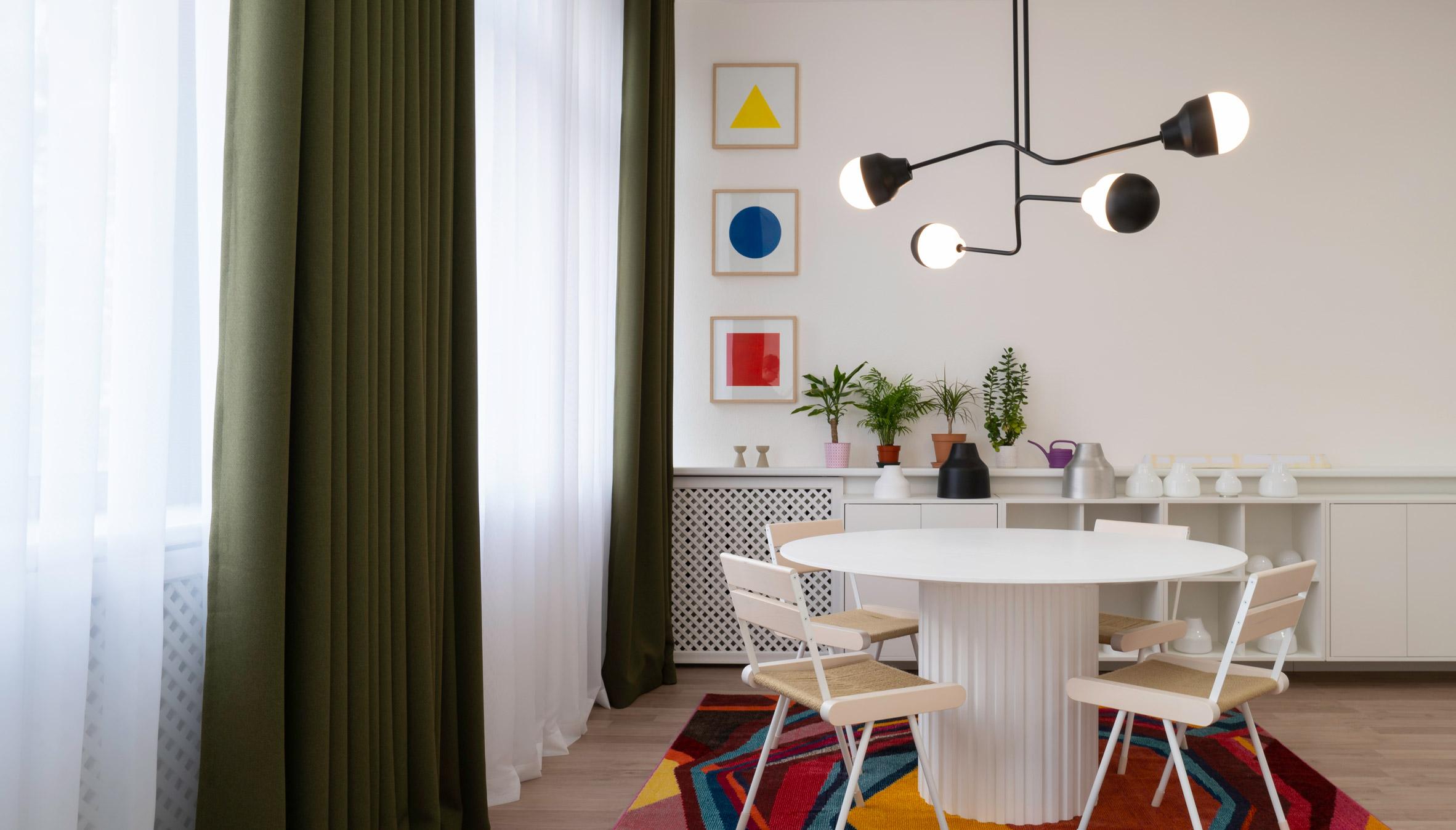 A room with a chandelier by Estonian studio Saarepera & Mae
