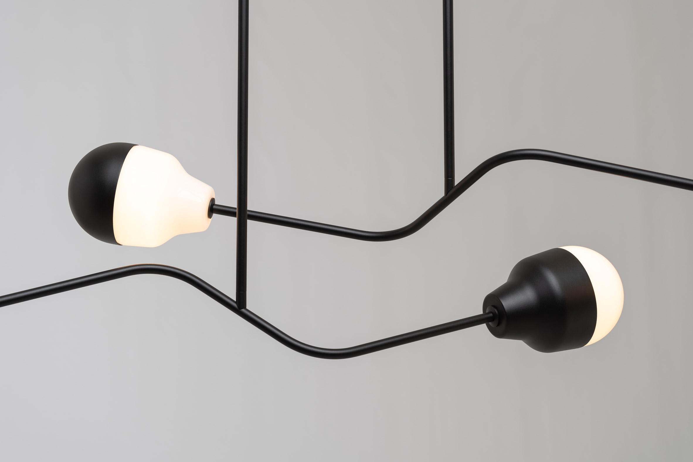 A detail photo of a black steel chandelier by Saarepera & Mae