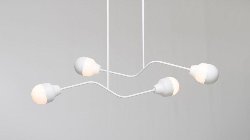 A white-painted aluminium chandelier by Estonian studio Saarepera & Mae
