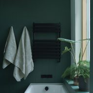 A green bathroom in a house renovation in London by DeDraft