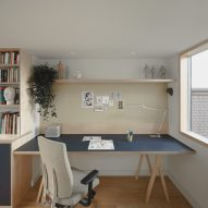 A workspace in the attic of a house in London by DeDraft
