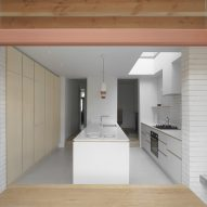 The white kitchen of a house extension in London by DeDraft