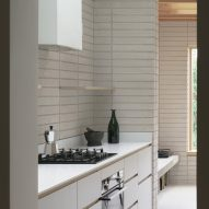 A white kitchen in a house extension in London by DeDraft