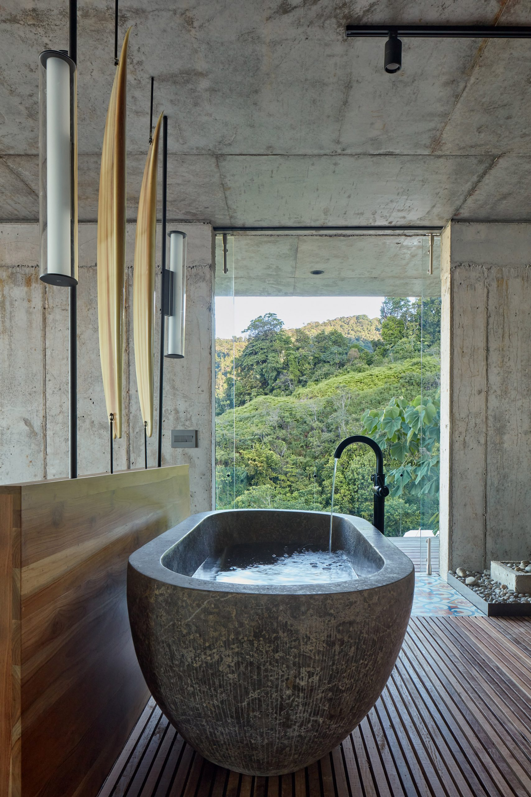 Concrete, freestanding bath with views of Costa Rican jungle
