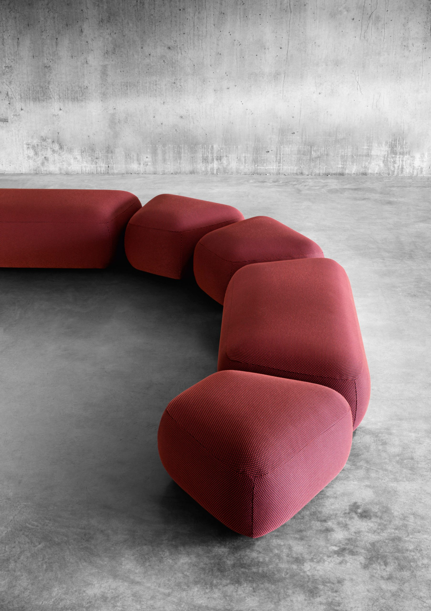 Backless modules from the Botera collection in a deep reddish pink
