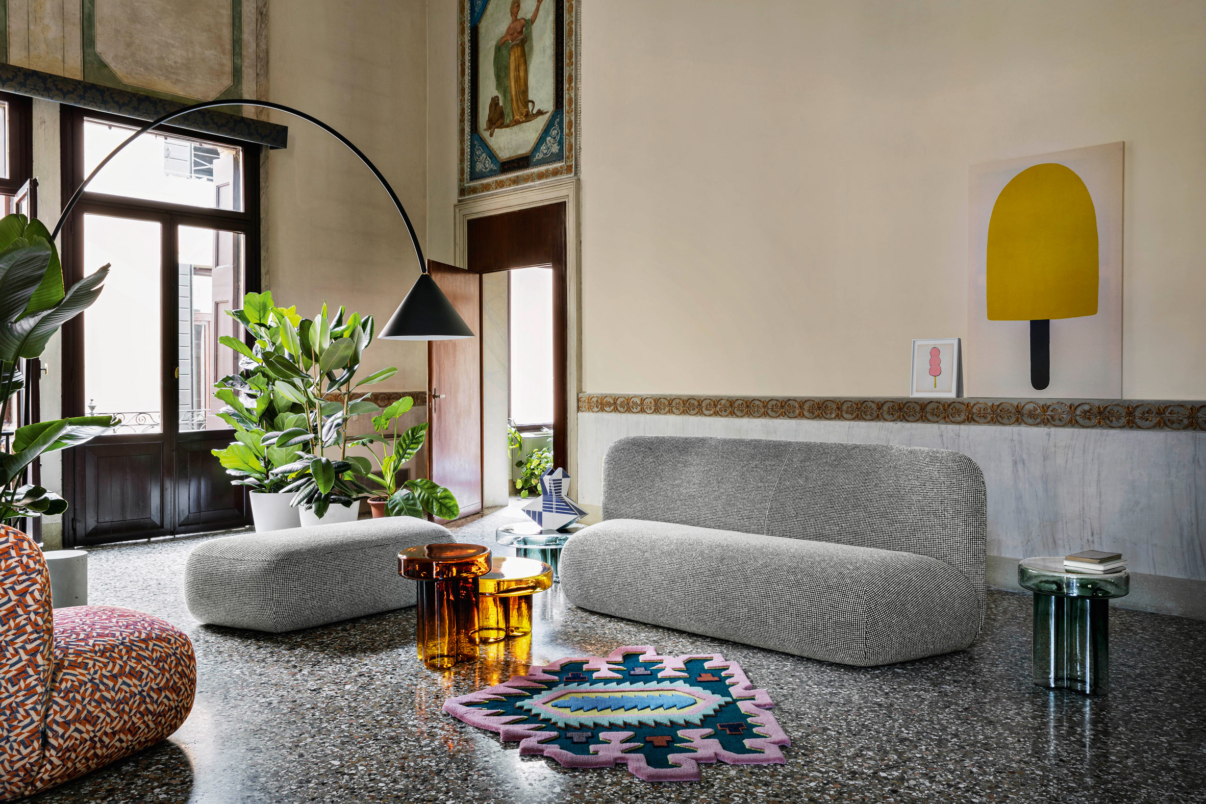 A grey sofa and a patterned module by Miniforms