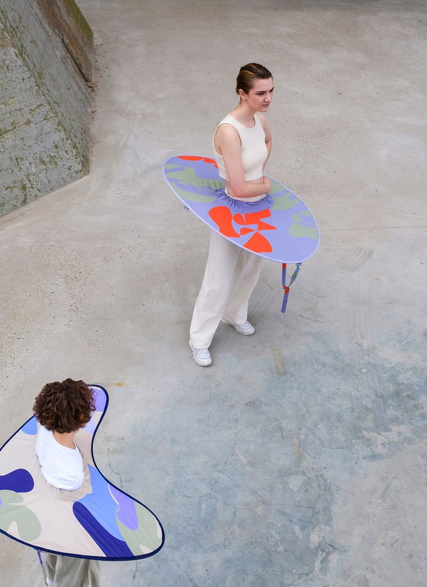 Aerial view of people wearing expanded distance keeper from the Bounding Spaces collection
