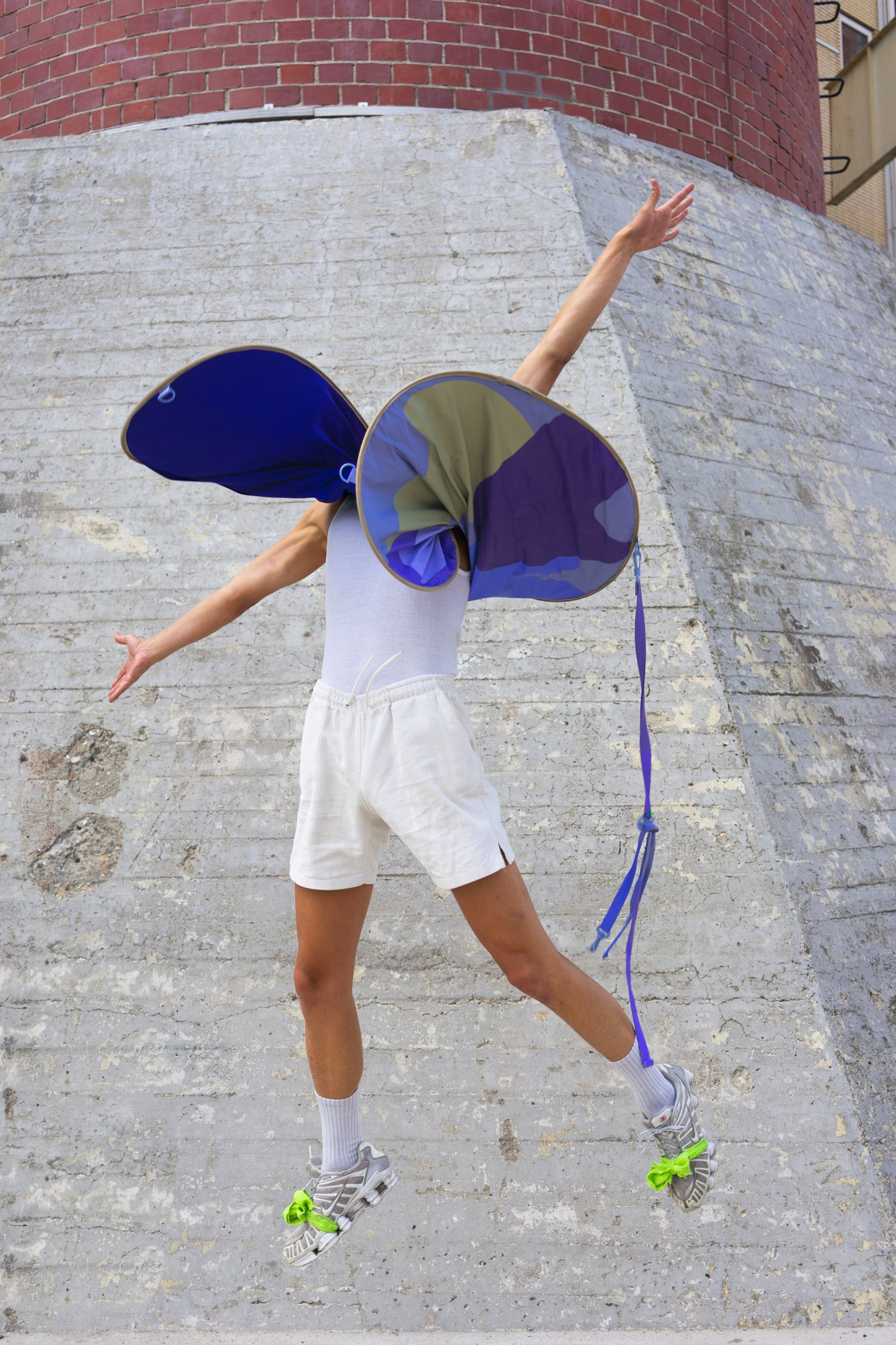 Person wearing a distance keeper from the Bounding Spaces collection by Anna-Sophie Dienemann