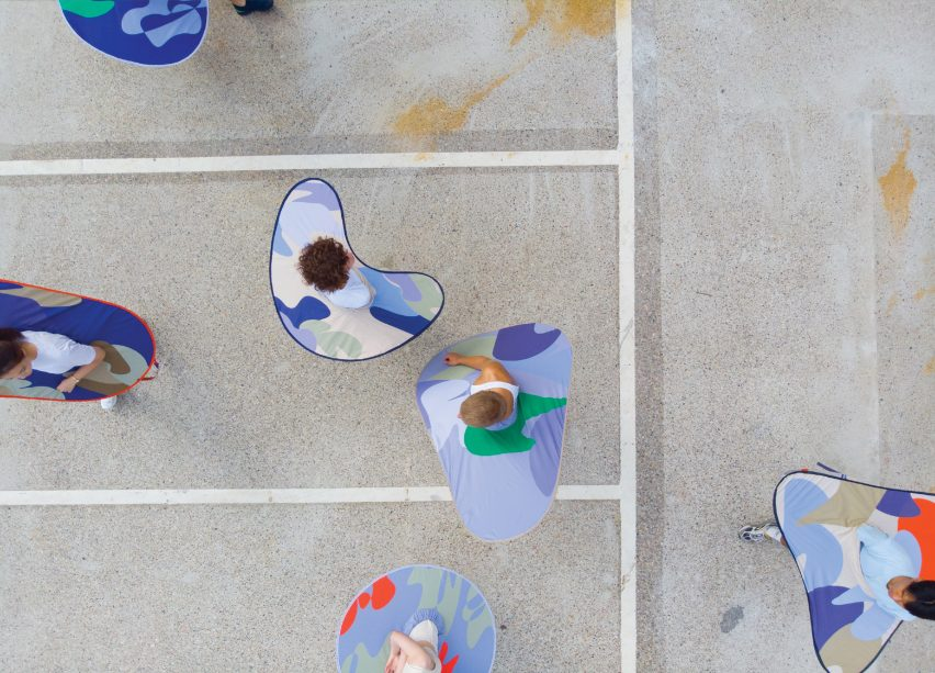 Aerial view of people wearing distance keepers from the Bounding Spaces collection