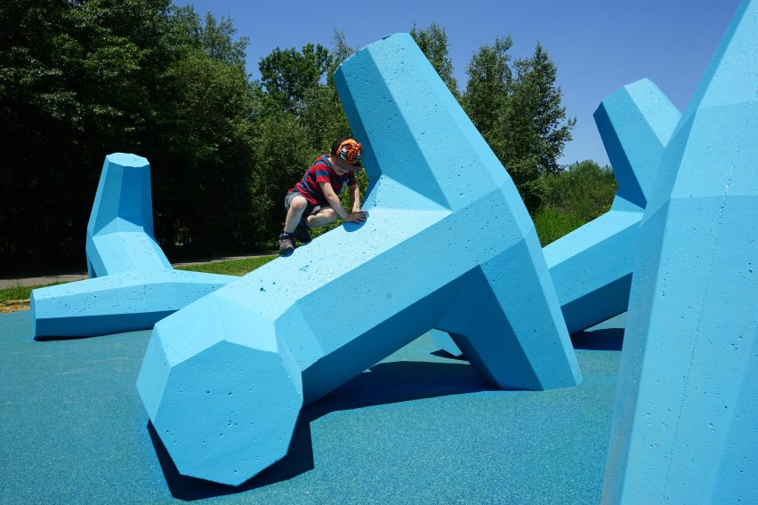 The playground's rubber surface acts as fall protection