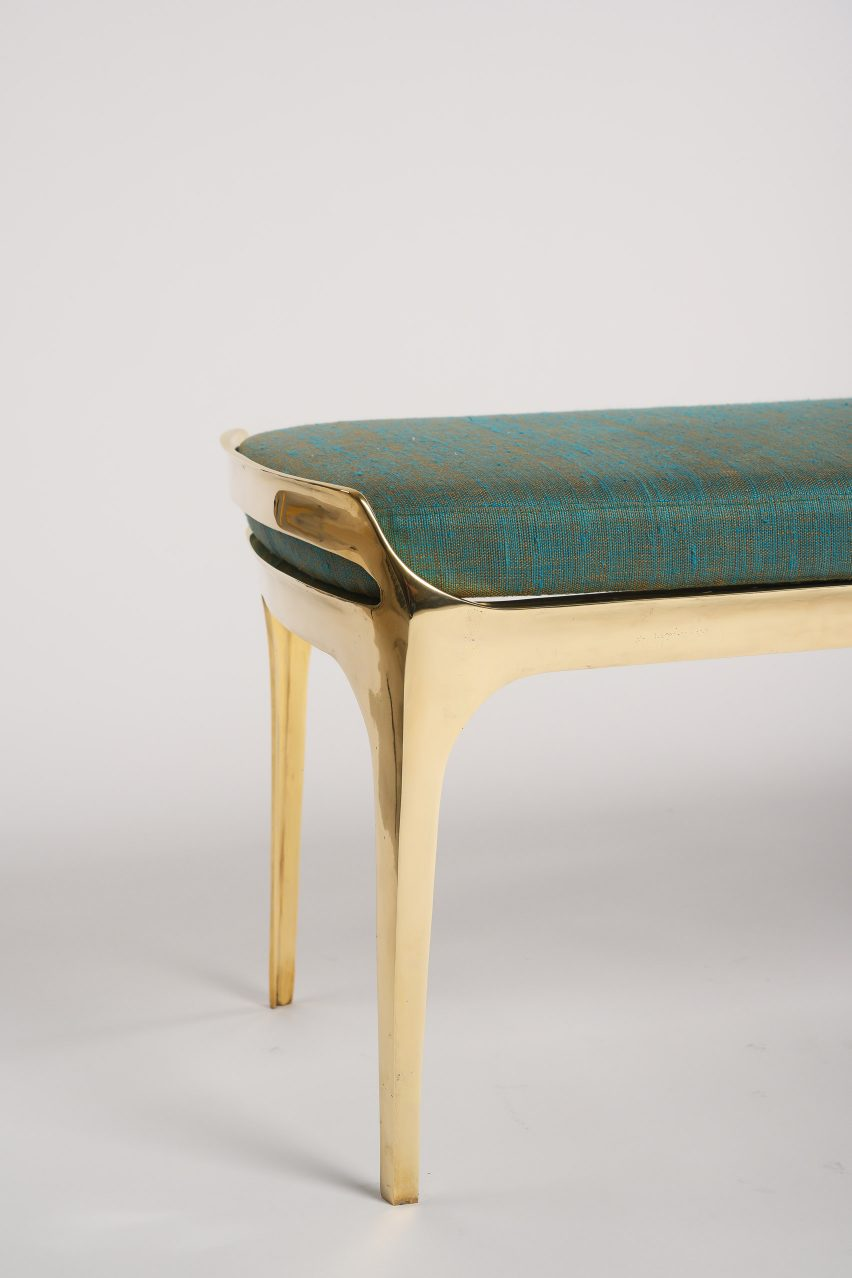 End of Bruda bench by Elan Atelier showing its gleaming gold finish