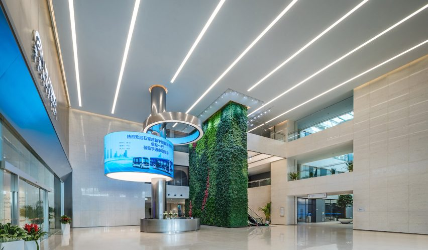 Lobby with green wall in redesigned Zhengzhou Yutong Bus headquarters