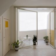 Merooficina carves up former fisherman's house into two bright apartments