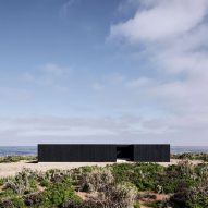 Architect builds his own blackened pine-clad house in Chile