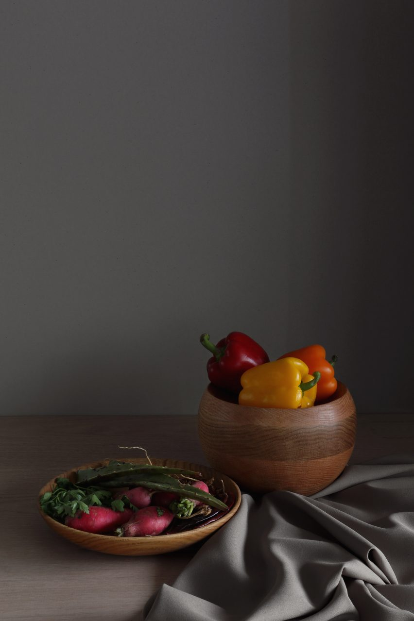 Wooden serving bowls with fruit in them