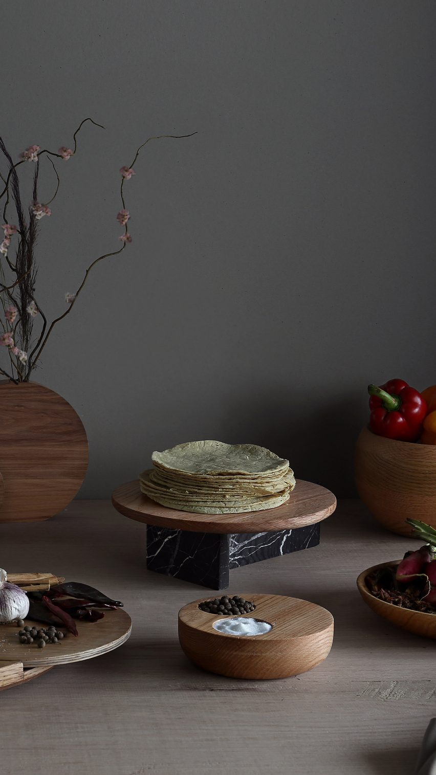 The marble serving plates made by Escalona's students contrast with other wooden objects