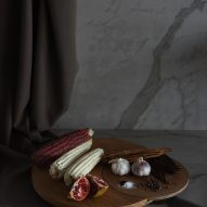 Wooden serving platters with fruit and vegetables atop