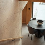 Stone walls are paired with wooden panelling