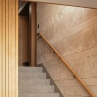Stone stairs with wooden handrail